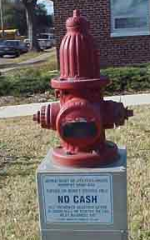 Fire hydrant shaped utility drop box
