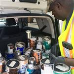 Worker counts paint cans