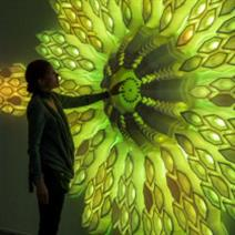 woman touching large, glass flower